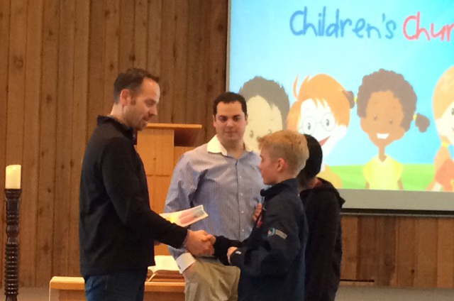 Students receiving certificates for completing the Discover 4 Yourself kids study of Jonah