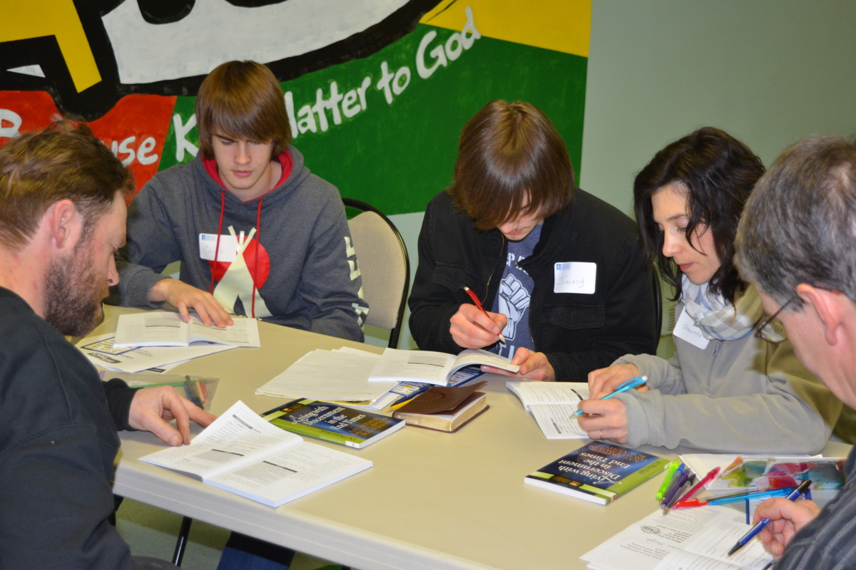 Youth and adults studying together in Lower Coverdale
